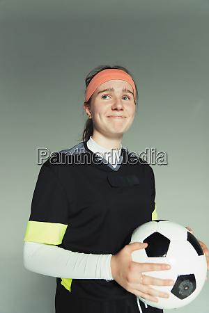 portrait smiling confident teenage girl soccer