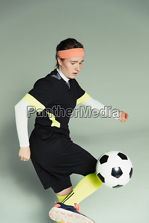 teenage girl soccer player with soccer