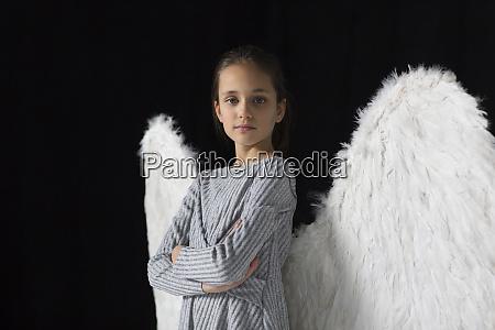 portrait confident brave girl wearing angel