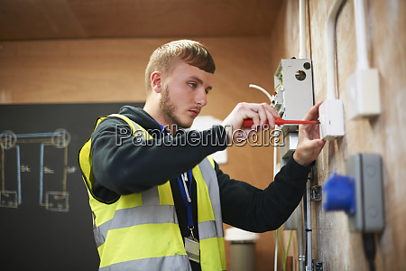 male electrician student practicing in workshop