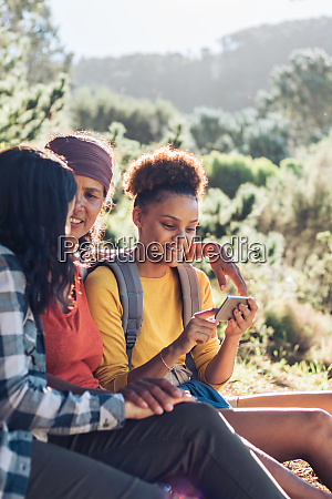 mother and daughters using smart phone