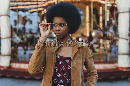 young woman with afro hair putting