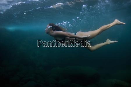 woman swimming underwater