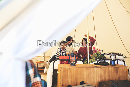 happy family relaxing in camping yurt