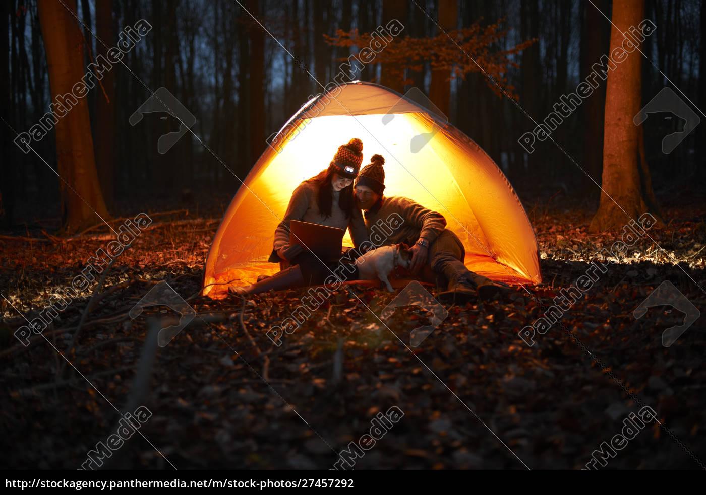 couple, using, digital, tablet, inside, glowing - 27457292