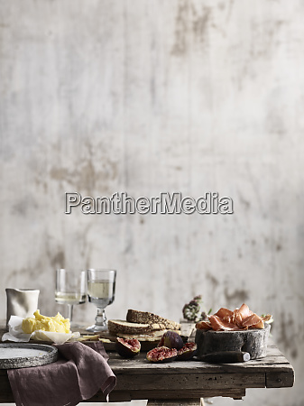 spread of bread butter figs and