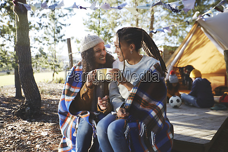 happy lesbian couple relaxing drinking coffee