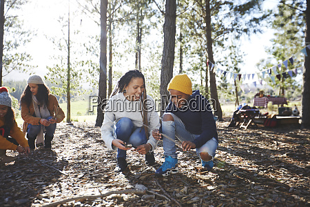 mother and son gathering firewood kindling