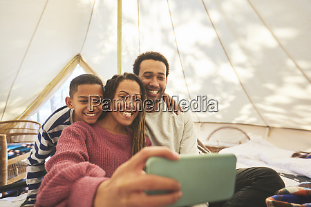 happy affectionate family taking selfie in