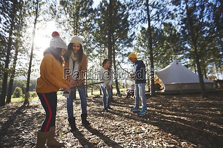 lesbian couple and kids gathering firewood
