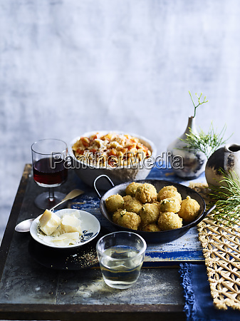 prawn salad and fritter dish served