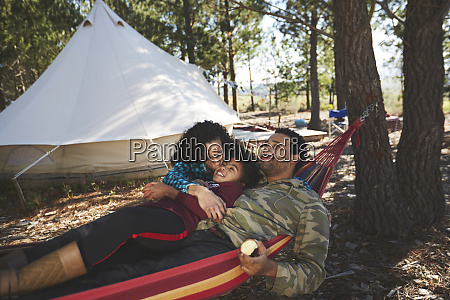 happy carefree family relaxing in hammock