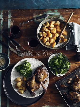 duck confit roast potatoes and broccoli