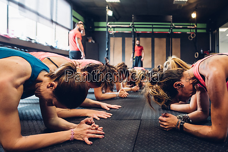 women training in gym with male
