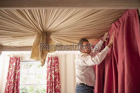 curtain fitter fitting drapes to four
