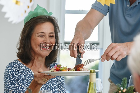 man serving woman at dining table