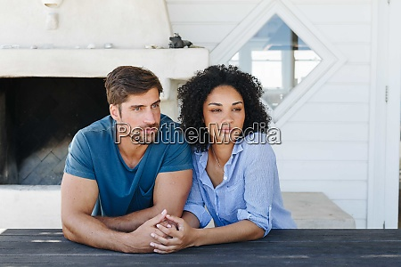 couple in deep thought in beach