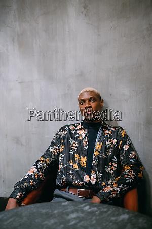 stylish man concrete wall background