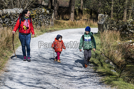 mother and sons exploring national park