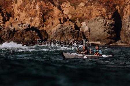 friends kayaking in sea big sur