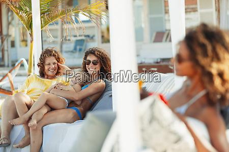 happy multi generation women relaxing on