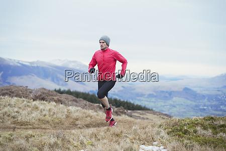 man jogging on mountain