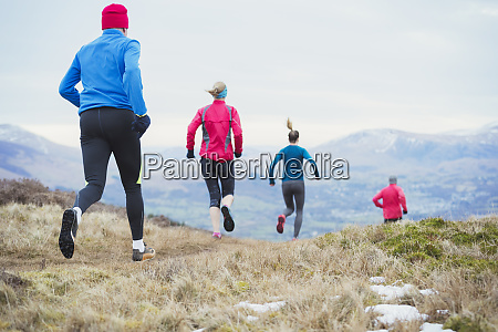 friends jogging in mountains