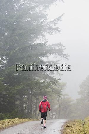 woman jogging in rain