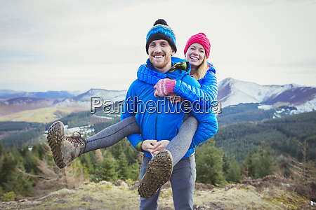 happy couple on mountaintop