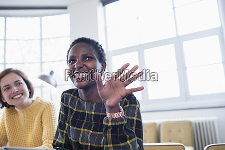 happy businesswoman talking in meeting
