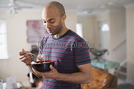 man eating at home