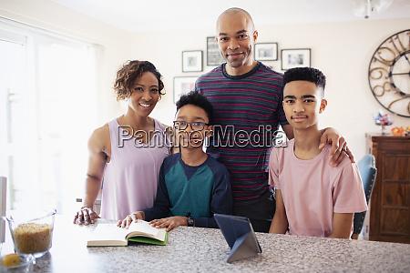 portrait smiling family in kitchen