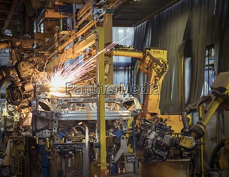 robots welding car bodies in car