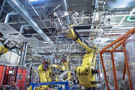 robots spot welding car parts in