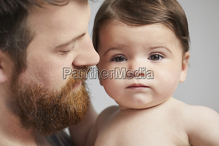 portrait of father with baby girl