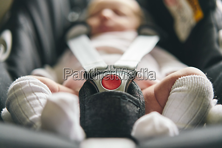 baby buckled up in baby cradle