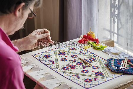 craftsman busy with needlework indoors Ile