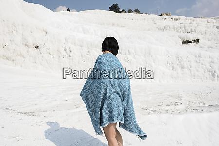 woman enjoying cotton castle pamukkale denizli