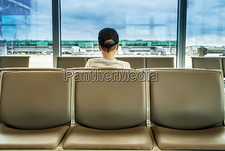 teenage boy on seat looking out