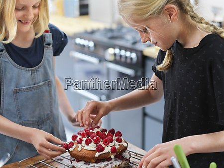 girl and her sister baking a