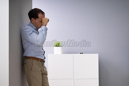 upset businessman in office