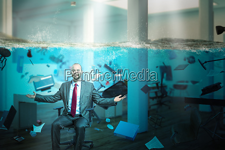 smiling businessman sitting in an office