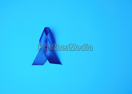 blue awareness ribbon on blue background