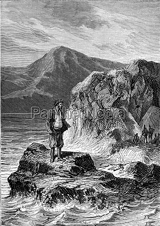 man standing on a rock on