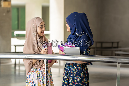 muslim teenager hold books and discussion