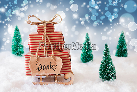 sled present snow danke means thank