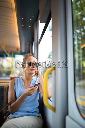 young woman on a city tram