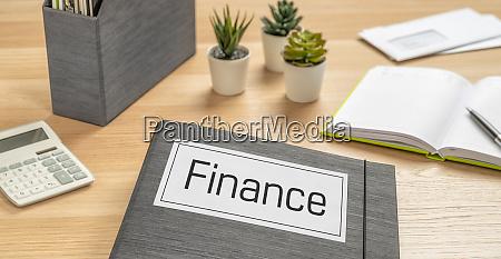 a folder on a desk with