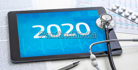 a tablet with the number 2020