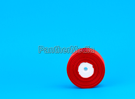 twisted bobbin of red textile silk